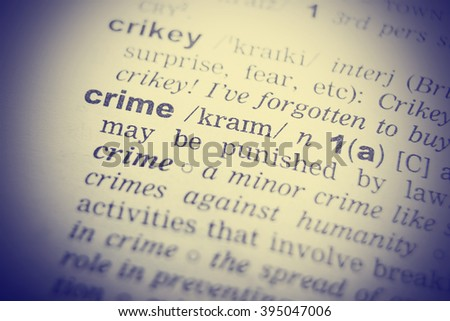 Dictionary definition of the word Crime in English. Vignetting effect. - stock photo