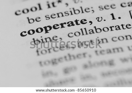 Dictionary Series - Cooperate - stock photo