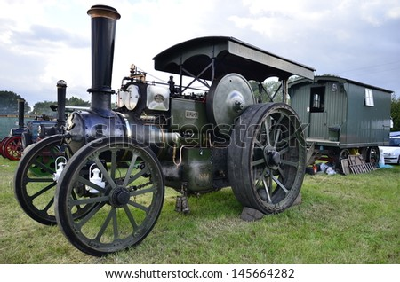 DIDCOT,OXFORDSHIRE,ENGLAND-JULY09-vintage steam traction engine with its owners on display in the show Woodcote Rally  a country fair on July 09,2011 in Didcot England - stock photo