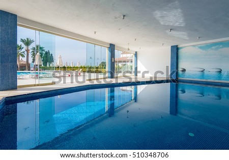 Didim, Turkey - October 29, 2016 : A hotel inside swimming pool view. Pool is for customer sport activity.