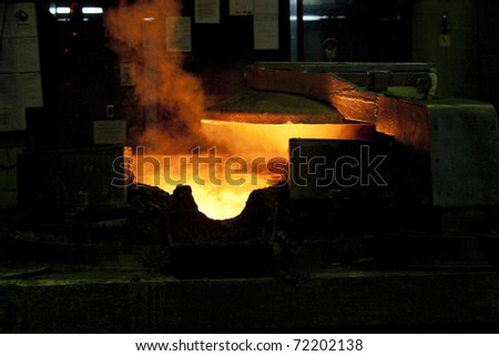 Die casting process - stock photo