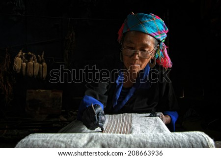 Dien Bien Phu, Dien Bien, Vietnam August 1, 2014: The H'mong ethnic women in the high mountains of decorative painting on canvas, this is one of their traditional occupation.