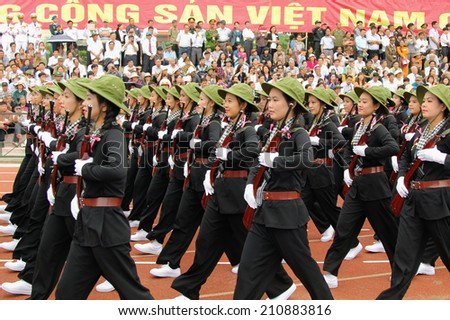 Dien Bien Phu, Dien Bien, VIETNAM May 7, 2014: The 60th anniversary of the Dien Bien Phu victory: Female militia of South Vietnam military parade celebrating the 60th victory of Dien Bien Phu
