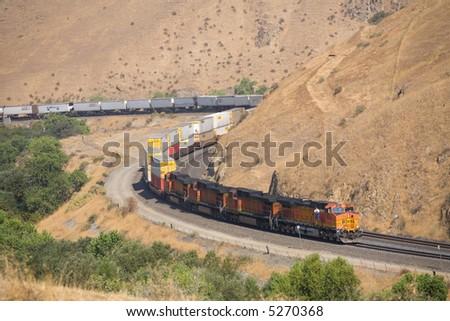 Diesel electric locomotives drag their train up Tehachapi Mountain, California - stock photo
