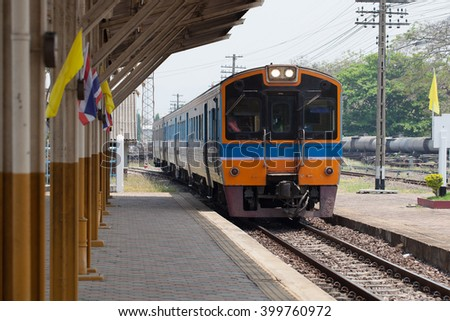 Diesel Engine Train locomotive approaching to Railway Station in Thailand - stock photo
