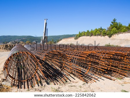 Diesel Pile Driver and iron cage - stock photo