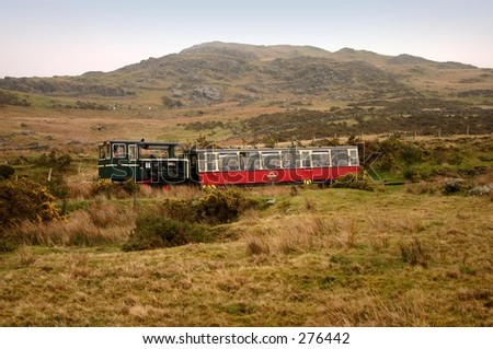 Diesel Train on the Snowdon Mountain Railway during a wet day - stock photo