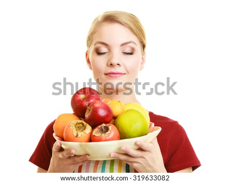 Diet and nutrition. Happy housewife or chef offering healthy fruit closed eyes smelling isolated