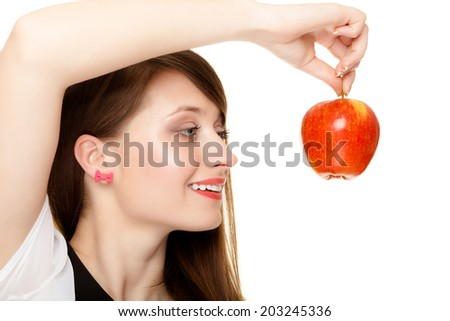 Diet and nutrition. Happy young woman holding apple seasonal fruit isolated on white. Girl recommending healthy lifestyle. - stock photo