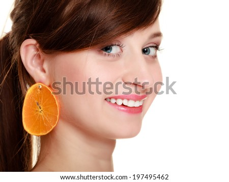 Diet and nutrition. Portrait of happy girl young woman with earrings of orange tropical fruit isolated on white. - stock photo