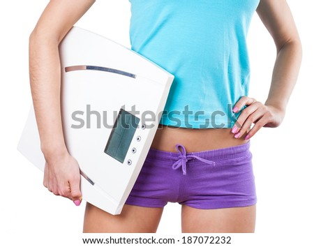 Diet and sport concept - young sporty woman with scale on white  - stock photo