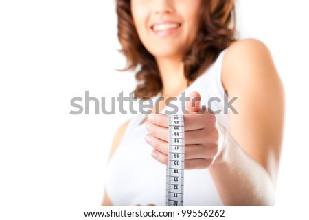 Diet and weight, young woman with a measuring tape for controlling her measure - stock photo