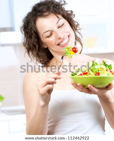 Diet.Beautiful Young Woman Eating Vegetable Salad