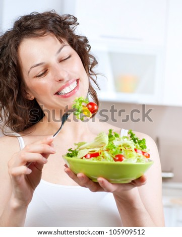 Diet. Beautiful Young Woman Eating Vegetable Salad. Dieting concept.Healthy Food