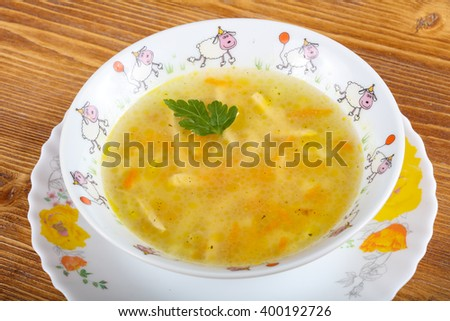 Diet Chicken soup with parsley on wood background - stock photo
