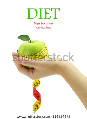 Diet concept. Female hand holding fresh apple with measuring tape - stock photo