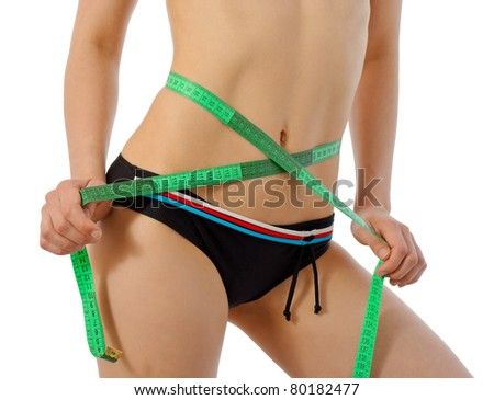 diet concept: girl with tape measurer - stock photo