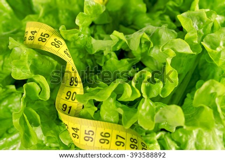 Diet concept -  lettuce and  measure tape  - stock photo