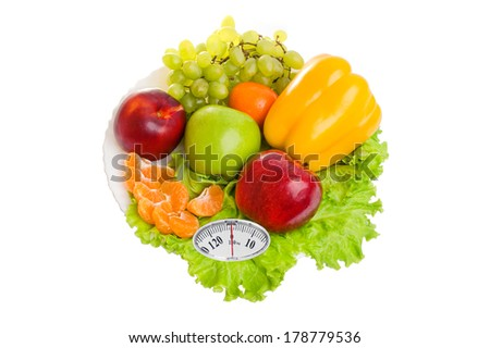 Diet concept. ?olorful fruit, salad and pepper on a plate with weight scale isolated on white background - stock photo