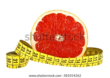 Diet concept: slice of grapefruit and measuring tape on white background - stock photo