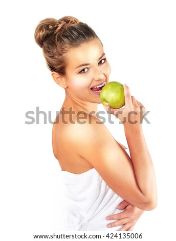 Diet. Dieting concept. Healthy Food. Beautiful Young Woman biting green apple. Fit.  Holding Apple Smiling at Camera. Beautiful healthy woman. Weight loss.  - stock photo