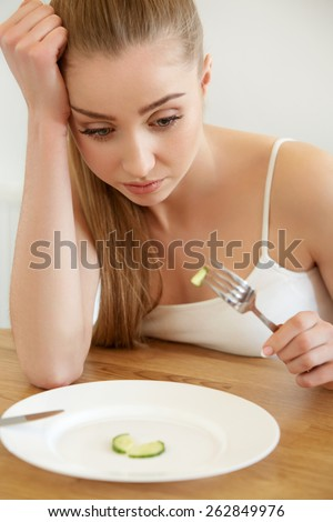 Diet. Dieting concept. Healthy Food. Beautiful Young Woman eats   - stock photo