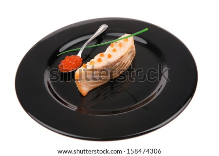 diet food : baked pink salmon steaks with green onion and red caviar in spoon on black dish isolated over white background - stock photo