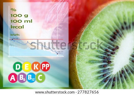 diet, food, healthy eating and objects concept - close up of ripe kiwi and grapefruit slices with calories and vitamins chart - stock photo