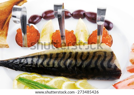 diet food - red caviar and smoked mackerel fish with lemon tomatoes and bread on white china plate isolated over white background - stock photo