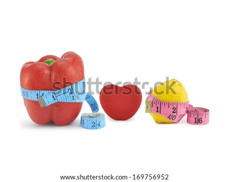 Diet Foods Red Pepper Burn Calories Measuring Tape Yellow Lemon Red Heart isolated on white background