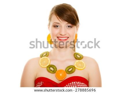 Diet. Happy girl with necklace and earrings of fresh citrus fruits isolated on white. Young woman recommending healthy food and nutrition. - stock photo