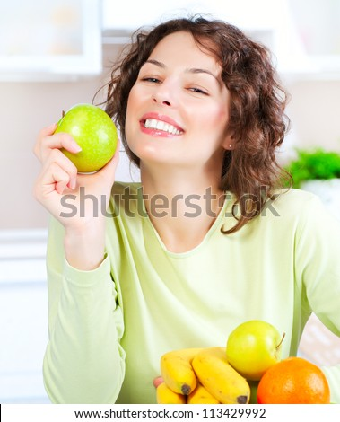 Diet. Happy Young Woman Eating Fresh Fruit. Dieting concept. Healthy Food. Vegan Food - stock photo