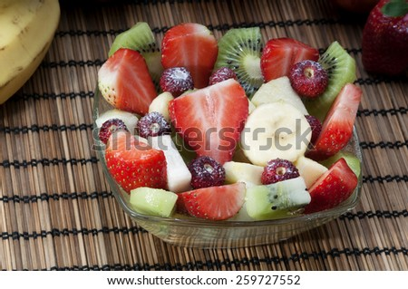 Diet healthy fruit salad in glass bowl healthy breakfast weight loss concept - stock photo