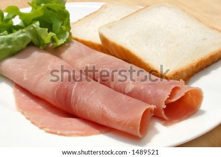 diet meal, rolled ham, salad and toast on plate - stock photo