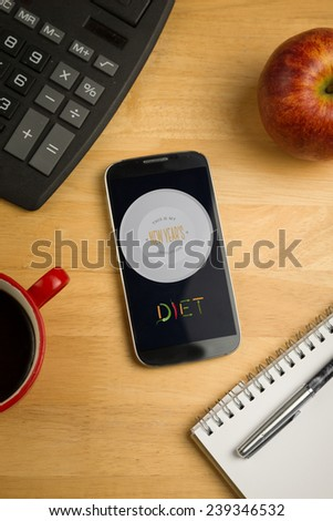 Diet new years resolution against overhead of smartphone with calculator - stock photo