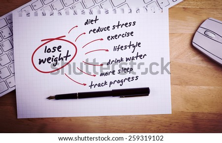 Diet plan against overhead of page and pen - stock photo