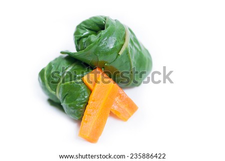 Diet rolls with chard served with carrot isolated on white background. Shallow depth of field - stock photo