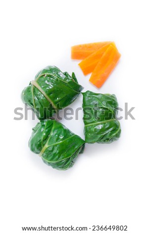 Diet rolls with chard served with carrot photographed from above, isolated on white background - stock photo