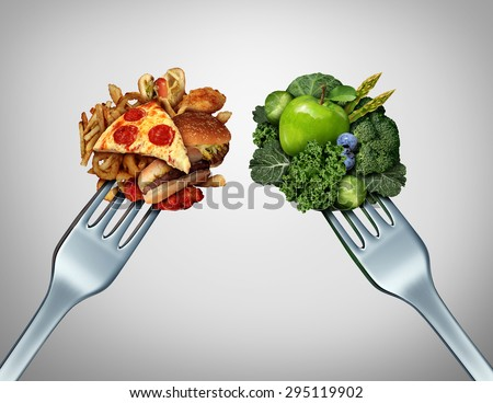 Diet struggle and decision concept and nutrition choices dilemma between healthy good fresh fruit and vegetables or cholesterol rich fast food with two dinner forks competing to decide what to eat.  - stock photo