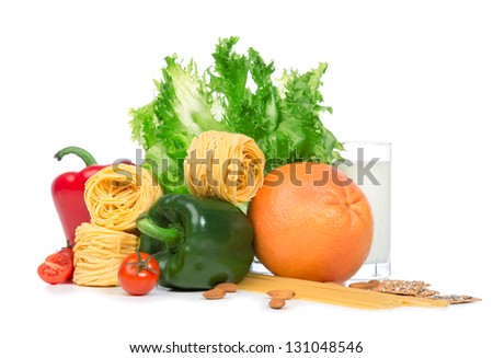 Diet weight loss breakfast concept. Fruits and vegetables organic green and red pepper, tomatoes, almonds, fresh salad, spaghetti, grapefruit, glass of milk on a white background