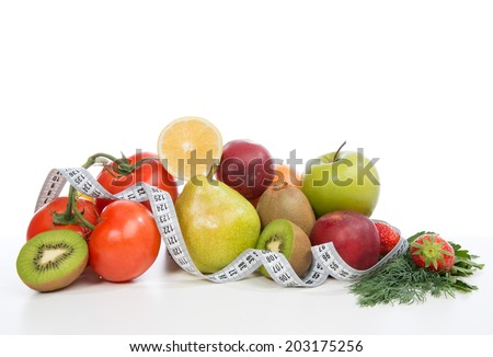 Diet weight loss breakfast concept with tape measure organic green apple,  tomatoes, strawberries, parsley, kiwi, grapefruit, pear  on a white background