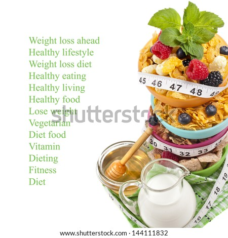 Diet weight loss breakfast concept with tape measure, tower stack isolated on a white background - stock photo
