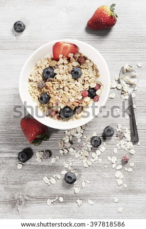 Diet weight loss breakfast, healthy life concept with home made muesli with fresh fruits on a wooden table - stock photo
