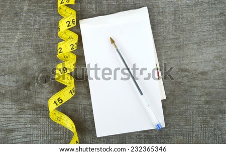diet, weight loss, measuring tape, healthy eating, healthy lifestyle concept.Notepad,diary - stock photo