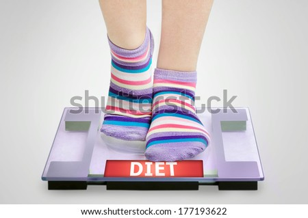 Diet word on grey scales - stock photo