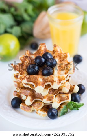 Dietary Belgian waffles with cream cheese and orange juice - stock photo