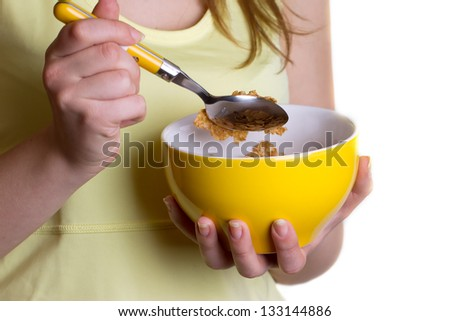 Dietary breakfast - a girl holding a yellow bowl of cereal
