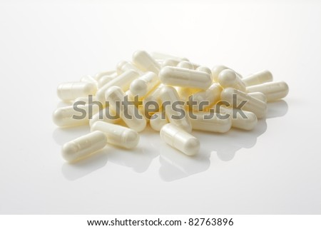 Dietary supplement on white background. - stock photo