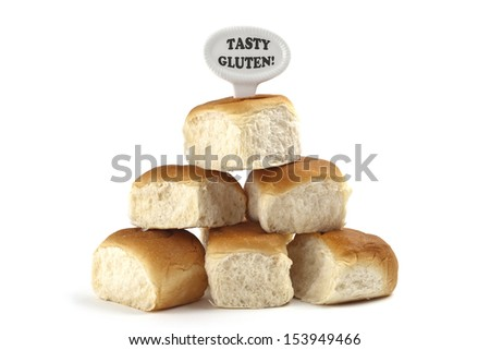 Dietary warning or gluten/wheat allergy warning (Fresh bread rolls with Tasty Gluten text tag on white background) - stock photo