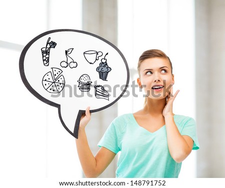 dieting and healthy eating - student showing text bubble with junk food and drinks icons - stock photo